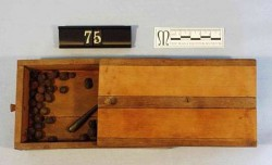 Figure 1: Cosmetics box, containing juniper berries, powered red ochre and a kohl stick, Wood, 12th Dynasty, Kahun, © Manchester Museum.