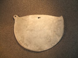 Cosmetic palette, with bore-hole, Nagada II.  © Manchester Museum.