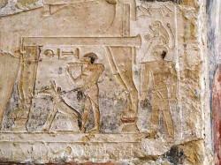 Figure 1. Dog with Monkey under chair of Nikauisesi.  Photograph courtesy of Osirisnet