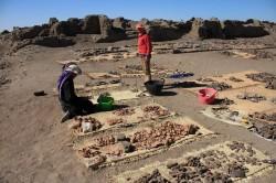 Figure 8-sorting ostraca at Edfu